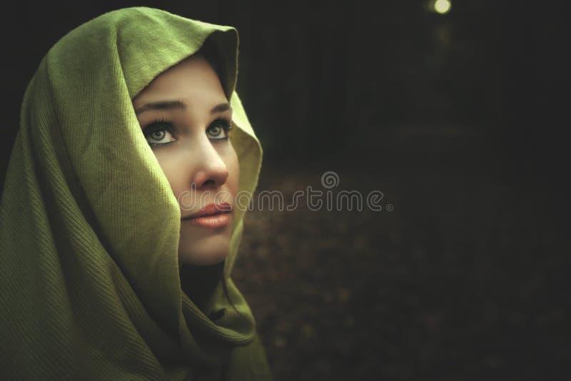 Dark night portrait of mysterious beautiful woman royalty free stock photo