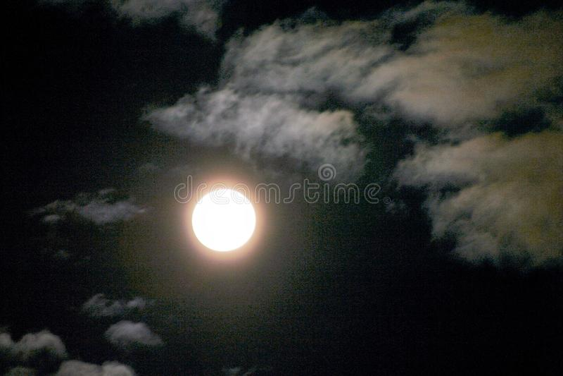 Dark night sky with full moon stock photography