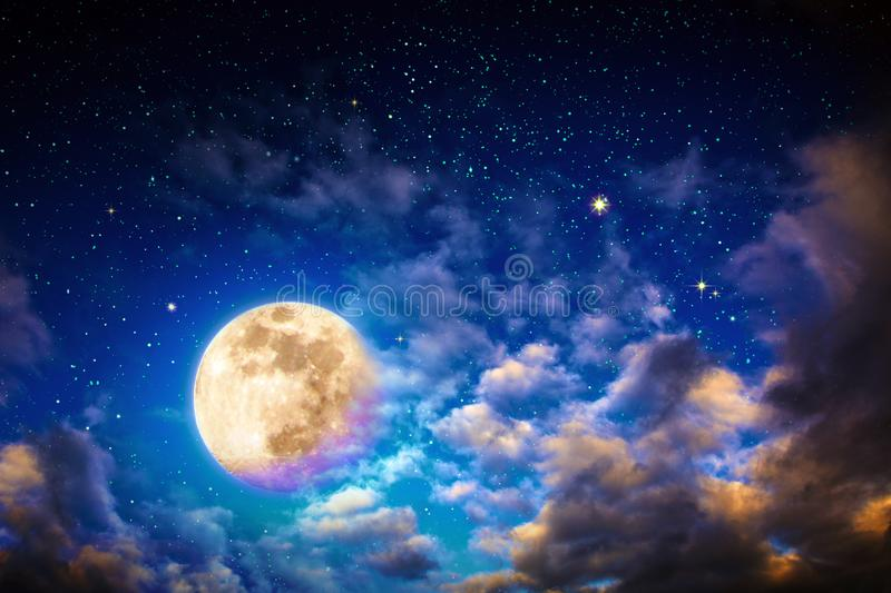 Dark night sky with stars with big clouds and full moon. Universe filled with stars and big clouds . Nature nights background with full moon stock image