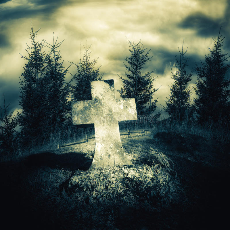 Dark night spooky landscape with abandoned grave. And memory stone next haunted mysterious forest under dramatic sky. Evil and nightmare concept royalty free stock images