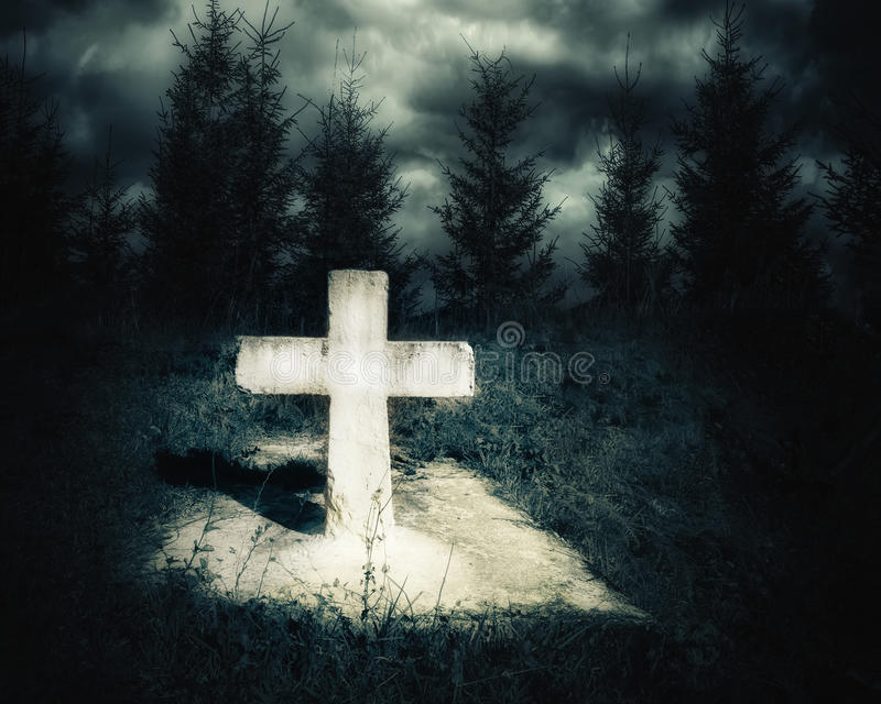 Dark night spooky landscape with abandoned grave. And memory stone next haunted mysterious forest under dramatic sky. Evil and nightmare concept stock photo