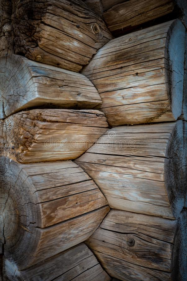 Dark old log wood wall of house royalty free stock image