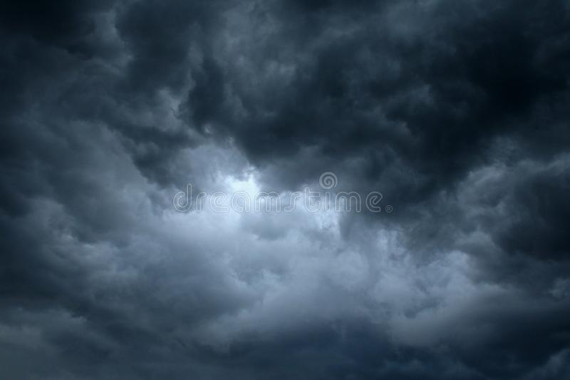 LIGHT FOCUS IN CENTRE OF STORM CLOUDS royalty free stock images