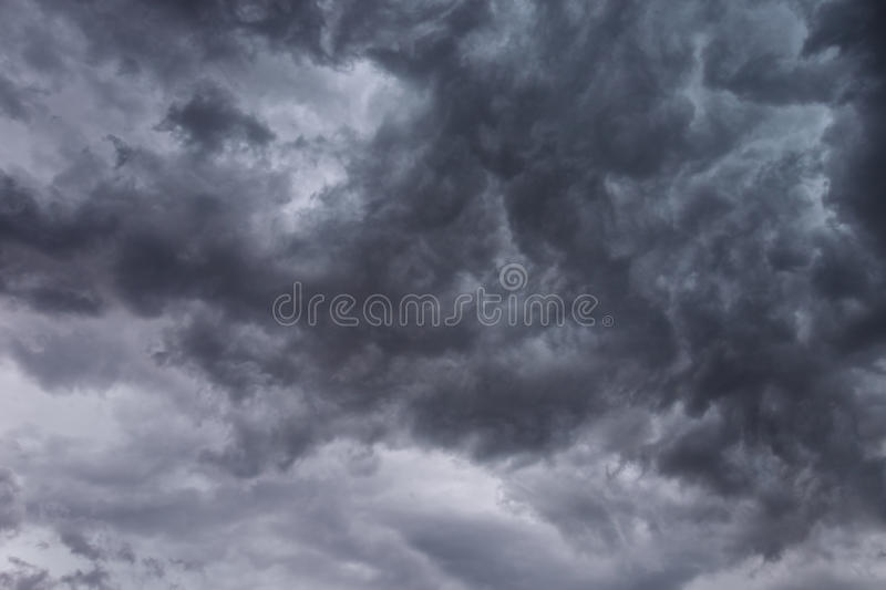 Dark Ominous Clouds. Dark, ominous stormy clouds forming over head. Makes for a great background royalty free stock photo