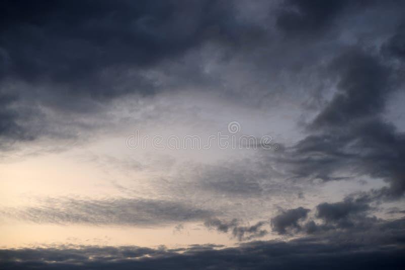 Dark ominous grey storm clouds. Dark ominous grey storm clouds at evening royalty free stock image