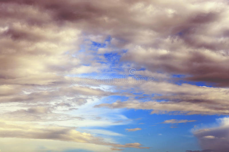 Dark, ominous rain clouds. Dark, ominous rain clouds and blue sky, may be used as background stock images