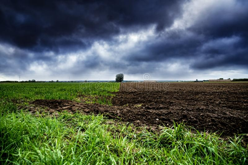 Dark, Ominous Rain Clouds . Before a rain . to plow the field . Storm in landscape royalty free stock images