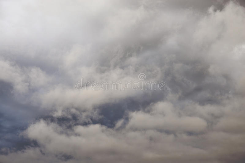 Dark, ominous rain clouds. Dark, ominous rain clouds, may be used as background royalty free stock photography