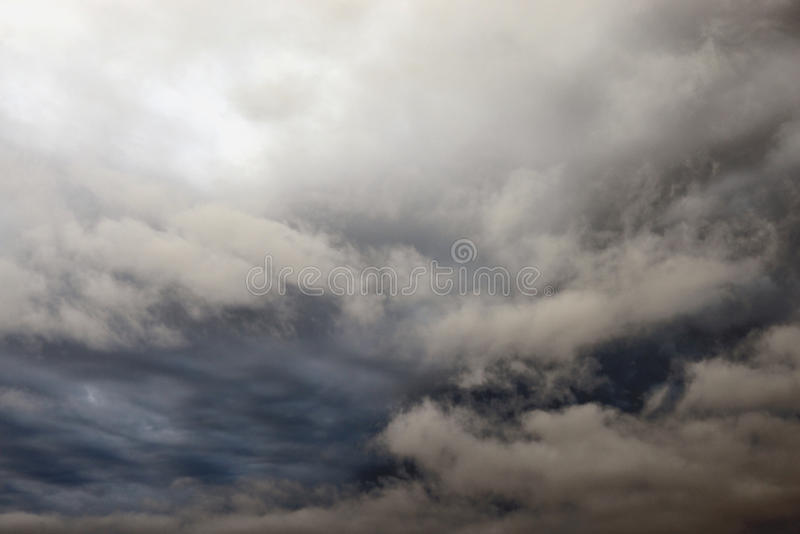 Dark, ominous rain clouds. Dark, ominous rain clouds, may be used as background stock image