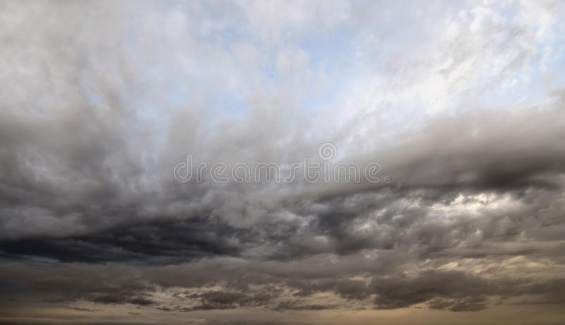 Dark, ominous rain clouds. Dark, ominous rain clouds, may be used as background royalty free stock images