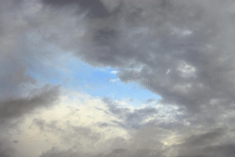 Dark, ominous rain clouds. Dark, ominous rain clouds, may be used as background stock photo