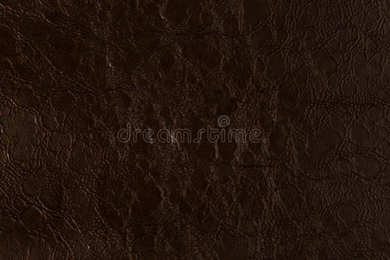Dark orange, brown leather texture, abstract background. stock image