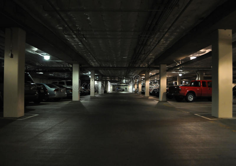 Dark parking structure royalty free stock photography
