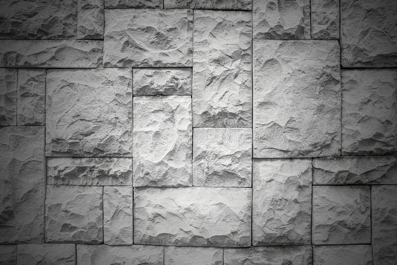 Dark pattern of decorative white slate stone wall surface texture background. Texture surface stock photo