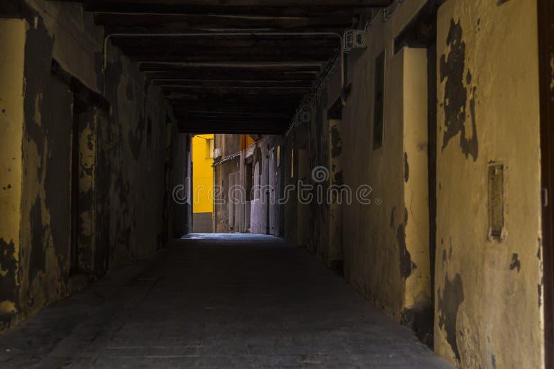 Dark pedestrian path tunnel stock photography