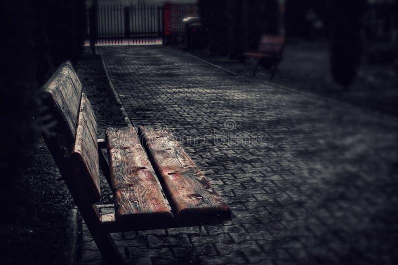 Dark photo of a bench. royalty free stock photo