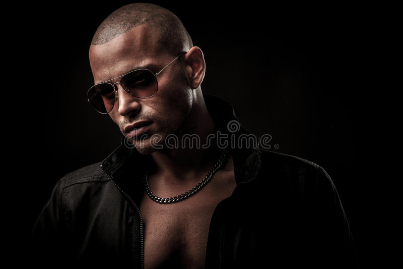 Dark photos of a mysteryous handsome young man with sunglasses royalty free stock image