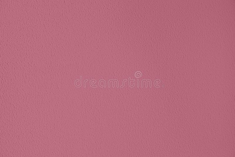 Dark pink colored low contrast Concrete textured background with roughness and irregularities. To your concept or product, abstract, backgrounds, building royalty free stock photography