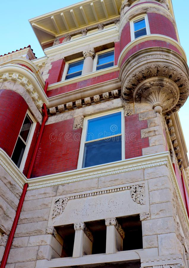 Dark pink, Almost Red Building With Beige Trim. This retro or historic building is distinctive in its architecture. The craftsmanship that created these shapes stock images