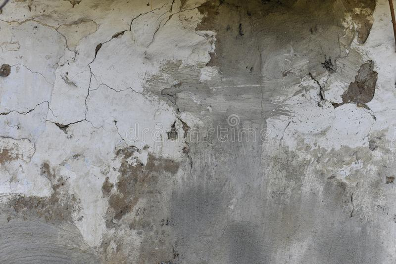Dark plaster scratched, black, white, red spots background. Old wall with gray stucco texture. Retro vintage worn wall wallpaper. royalty free stock photos