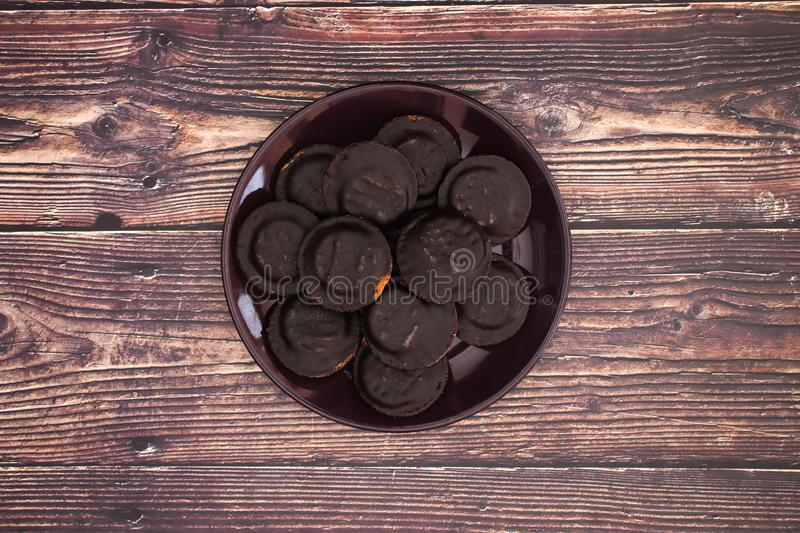 Dark plate withe chocolate cookies.  royalty free stock photo