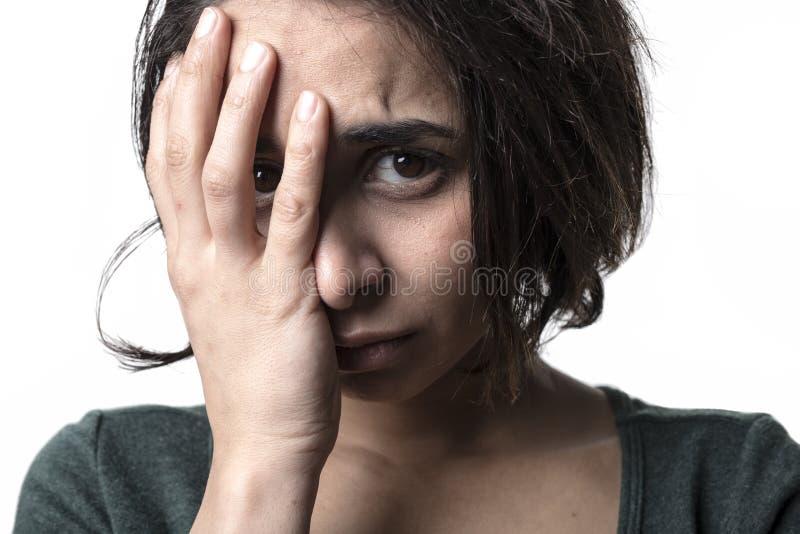 Dark portrait woman depress. A dark portrait of a depress woman royalty free stock image