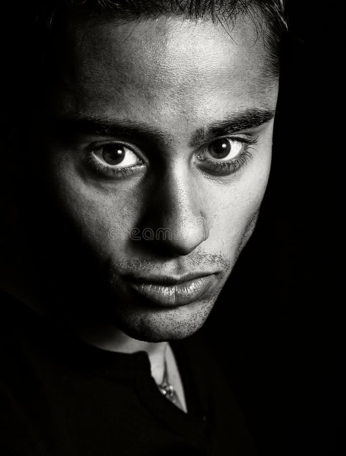 Dark portrait - face of one expressive man stock image