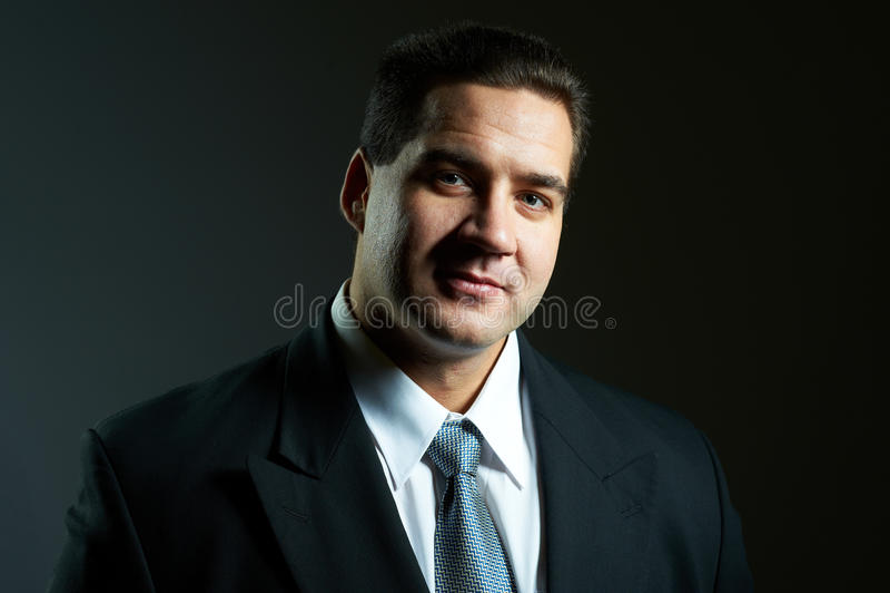 Dark portrait of handsome stylish young man stock photo