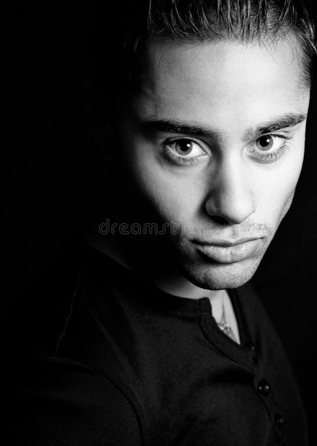 Dark portrait of one hispanic handsome man royalty free stock images
