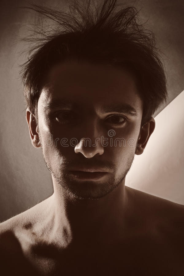 Dark portrait of a young man stock images