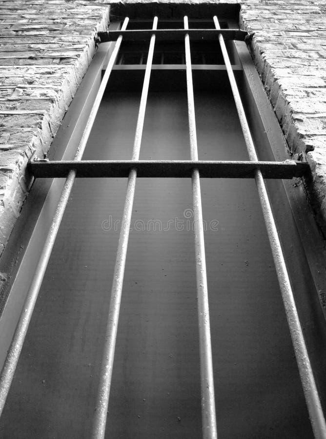 Dark prison window stock photo