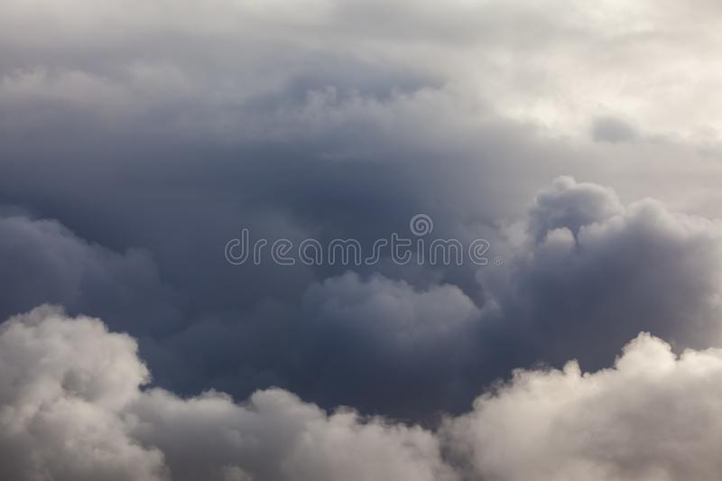 Dark puffy clouds sky background. Dark clouds skyscape with stormy rain weather in the sky. No horizon stock image