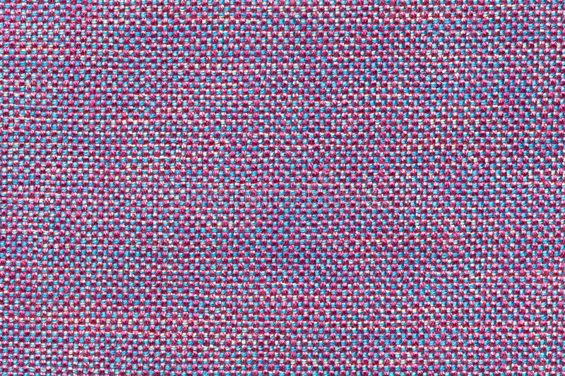 Dark purple and blue textile background with chess pattern, closeup. Structure of the fabric macro. Dark purple background with checkered pattern, closeup stock image
