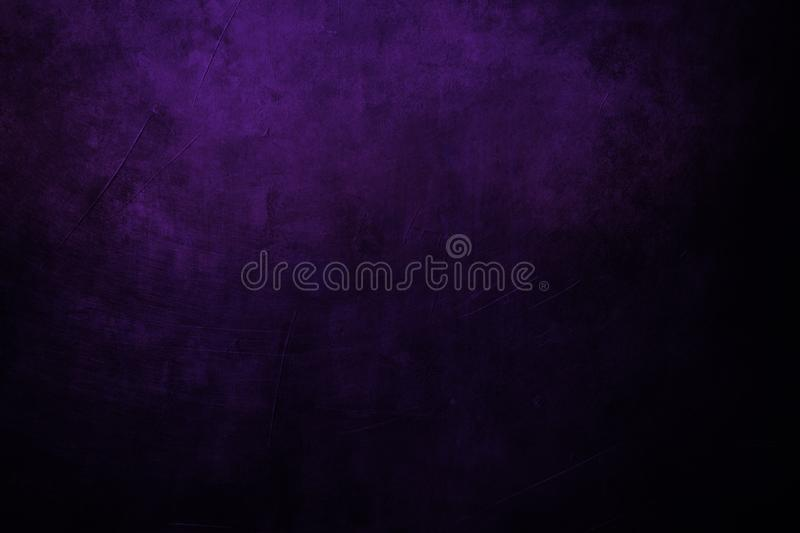 dark purple grungy background with spotlight background royalty free stock images