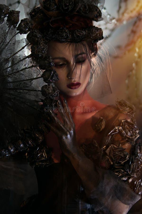 Dark queen in black fantasy costume royalty free stock photos