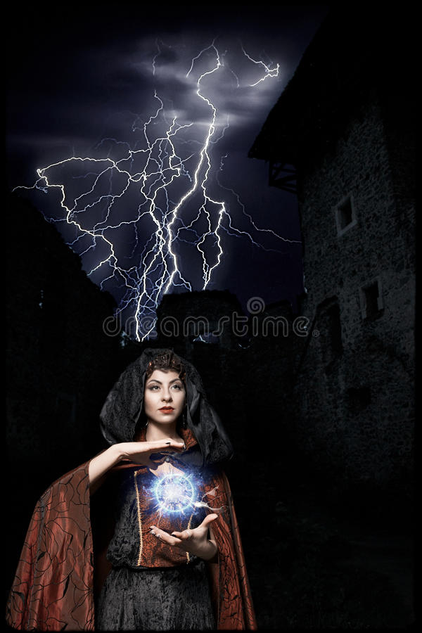 Dark queen of the ghost in a dark castle collapsed, causing lightning zipper magic hands visible destruction of the castle wall an stock image