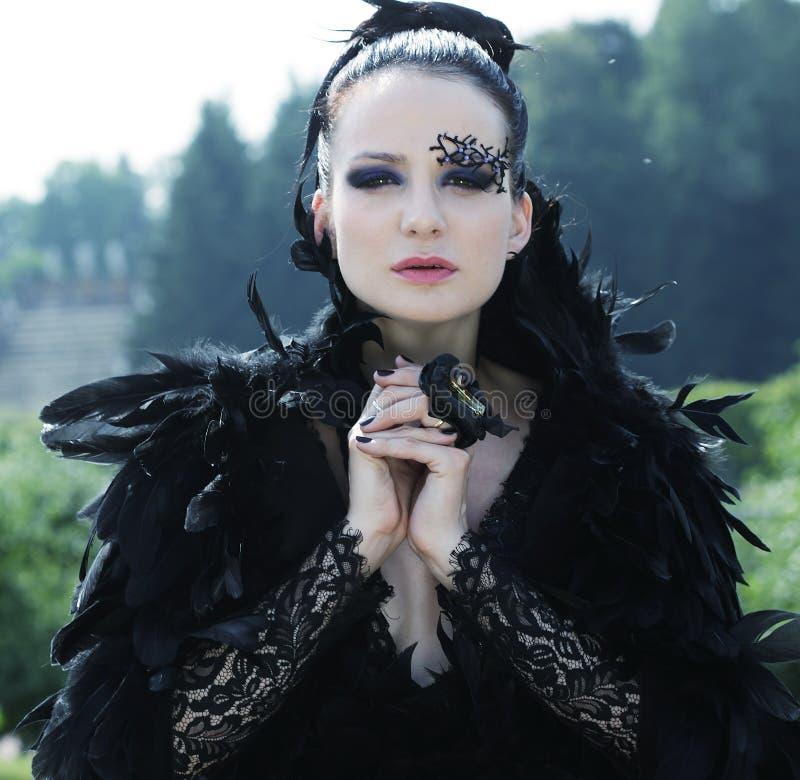 Dark Queen in park. Fantasy black dress royalty free stock photos