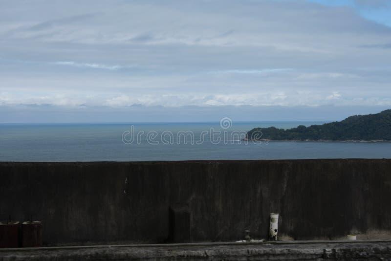 Dark and rainy sky on the beaches of sant vicente. Dark and rainy sky on the beaches nof sant vicent Brazil royalty free stock photography