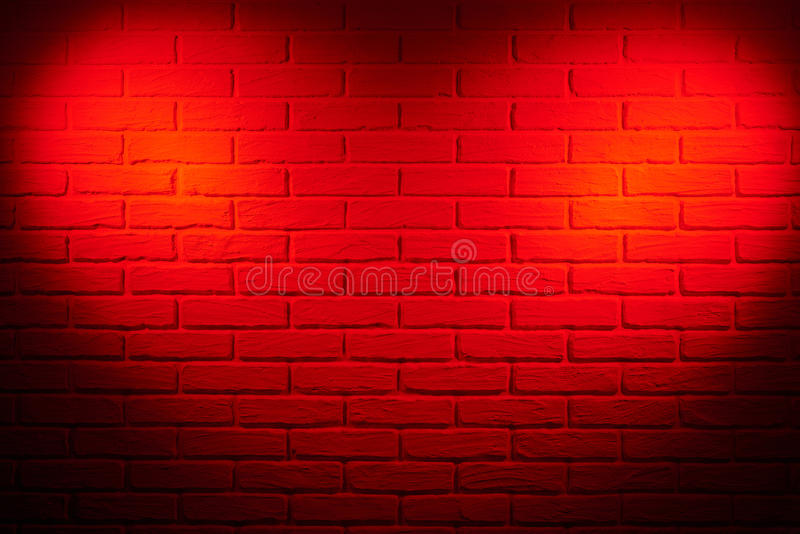 Dark red brick wall with heart shape light effect and shadow, ab. Stract background photo royalty free stock images