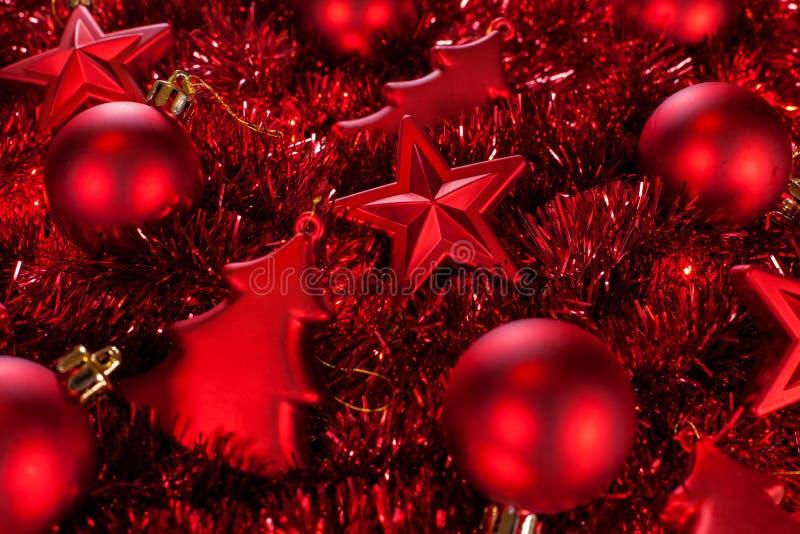Red christmas ornaments closeup - holidays background. Dark red christmas ornaments and garlands closeup - holidays season background - video also available stock image