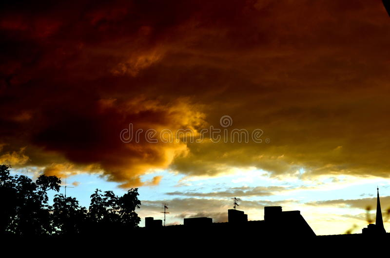 Dark red clouds over houses. In a big city royalty free stock images