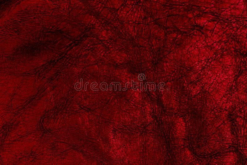 Dark red leather surface as a background, leather texture. stock photography
