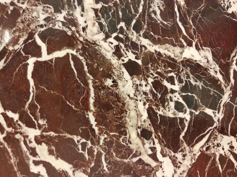 Dark red marble as a background, texture stock photo
