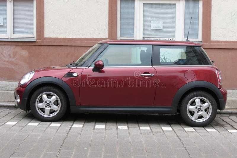 Dark red or maroon Mini Cooper car stock photo