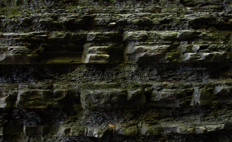 Dark rock wall in an old deep well in the catacombs. Rock wall in an old deep well in the catacombs stock photos