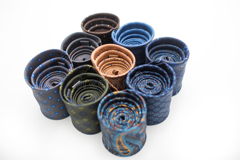 Dark rolled ties with colorful patterns royalty free stock photography