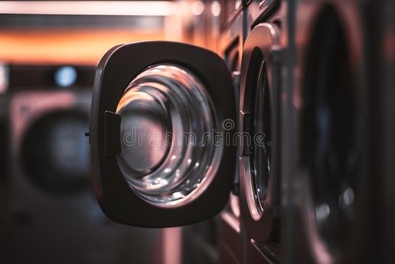 Dark laundry room with opened door stock photo