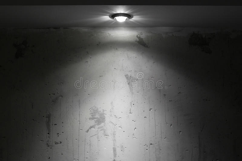 Dark room with spot light royalty free stock photography