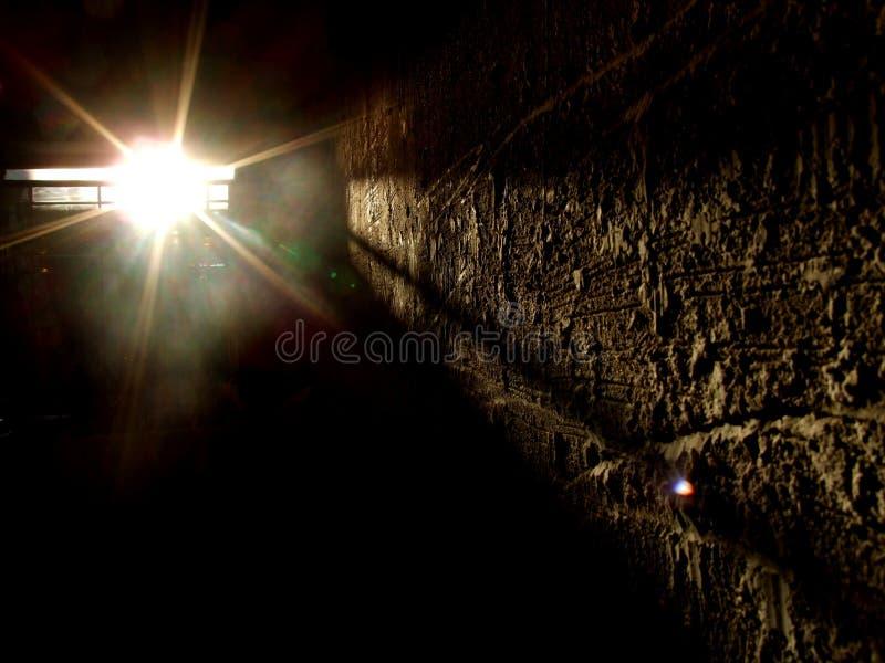 Dark room with spotlight stock photos