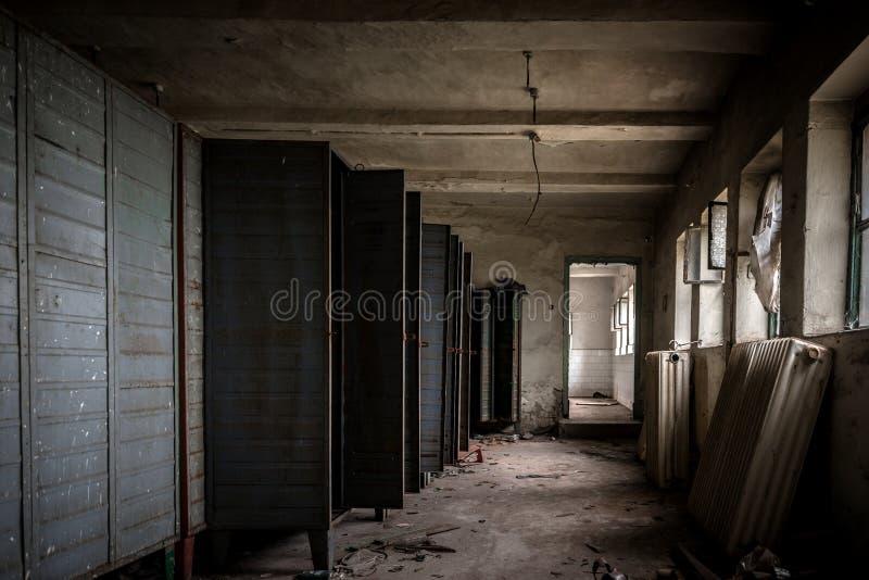 Dark room with steel lockers. Inside stock photography